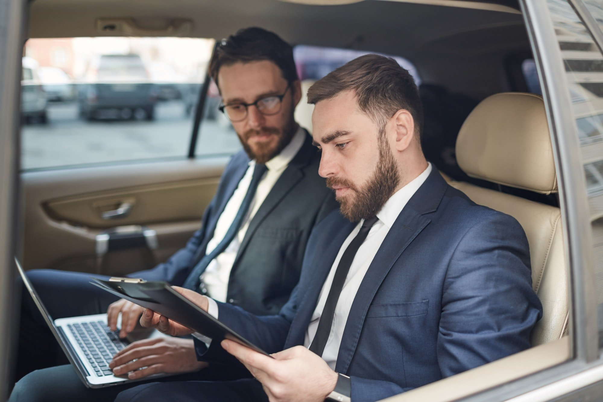 Business people working in the car for Smile Car Leasing
